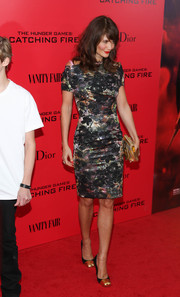 Helena Christensen showed off her gorgeous-as-ever supermodel figure in a classy printed sheath during the 'Catching Fire' NYC premiere.