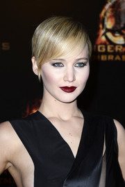 Jennifer Lawrence was a goth beauty with her dark red lips and heavily lined eyes.