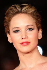 Jennifer Lawrence attended the 'Catching Fire' Rome premiere wearing her short hair slicked back in subtle waves.