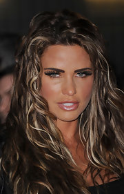 Katie Price added a pair of unbelievably long false lashes to create her sultry-eyed look for the European premiere of 'The Hunger Games.'