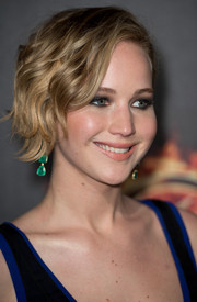 Jennifer Lawrence sported an edgy-cute short wavy 'do during the 'Hunger Games' cast party in Cannes.