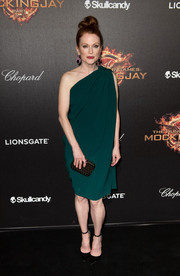 Dressed in a green one-shoulder dress by Lanvin, Julianne Moore had a diva-esque aura about her at the 'Hunger Games' cast party in Cannes.