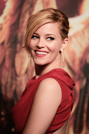 Elizabeth Banks swept her hair back into a classic chignon for 'The Hunger Games: Mockingjay Part 1' preview event in Berlin.