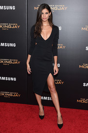 Sara Sampaio stayed on trend in a plunging LBD with waist cutouts during the 'Hunger Games: Mockingjay - Part 2' New York premiere.