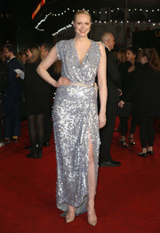 Gwendoline Christie brought major sparkle to the 'Hunger Games: Mockingjay Part 2' UK premiere with this Vivienne Westwood Couture wrap gown rendered entirely in silver paillettes.