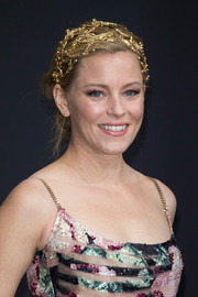 Elizabeth Banks looked enchanting from head to toe wearing this gold headpiece and print dress combo, both by Elie Saab, at the 'Hunger Games: Mockingjay - Part 2' world premiere.