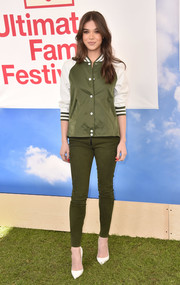 Hailee Steinfeld kept it youthful in an olive-green and white varsity jacket at the Hunter for Target Ultimate Family Festival.