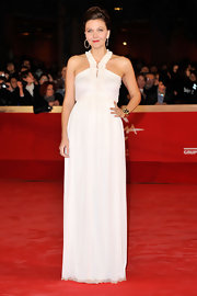 Maggie Gyllenhaal wore a white halter dress with a ruffled neckline for the 'Hysteria' premiere at the Rom Film Festival.
