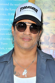 Slash's round sunglasses provided a sporty finish to his look during the LAUSD Love Elephants Youth Art Exhibit.