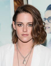 Kristen Stewart rocked tousled side-flipped messy cut to show off her brunette locks.