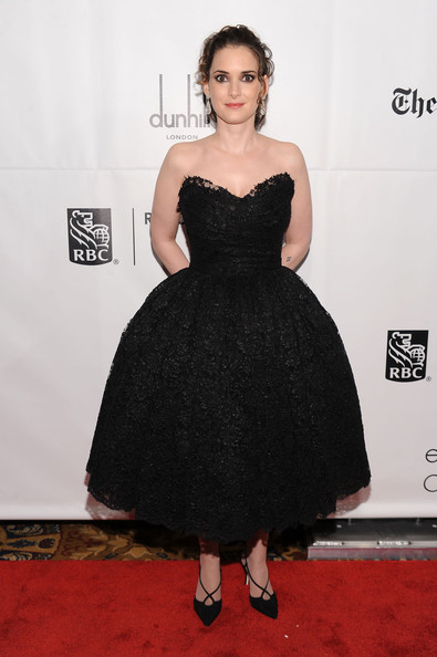 """Winona Ryder paired her full dress with strappy pointy toe pumps. The ballet inspired look was very befitting of the """"Black Swan"""" star."""