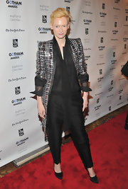 Fashion daredevil Tilda Swinton accessorized her menswear-inspired ensemble with classic black pumps.