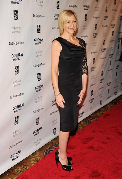 Edie Falco accessorized her ensemble with black satin d'orsay pumps complete with bow detailing.