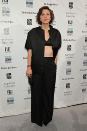 Maggie Gyllenhaal attended the Gotham Independent Spirit Awards wearing this black jacket, pants, and bra combo--definitely not your standard suit!