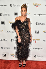 Jennifer Lopez paired her frock with a micro-beaded black clutch by Jimmy Choo.