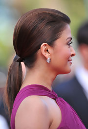 The actress looked polished in a sleek, low ponytail with a hair wrapped band.