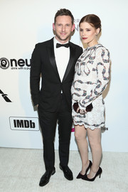 Kate Mara paired her dress with a purple plexi clutch by Tyler Ellis.