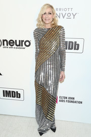 Judith Light glittered in a gold and silver sequined gown by Michael Kors at the Elton John AIDS Foundation Oscar-viewing party.