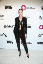 Toni Garrn teamed a black sequined suit by Siran with a lacy bandeau top for the Elton John AIDS Foundation Oscar-viewing party.