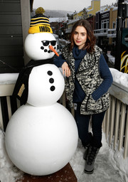 Lily Collins looked toasty in a black-and-white vest layered over a blue sweater while visiting the IMDb Studio at Sundance.