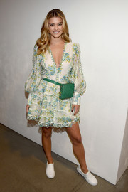 Nina Agdal completed her cute ensemble with a quilted green waist bag by Chanel.