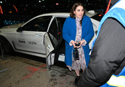 Beanie Feldstein arrived for the NYFW shows wearing a bright blue coat over a lavender floral dress.