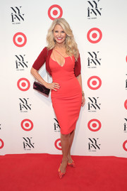 Christie Brinkley topped off her dress with a shrug sweater in a deeper shade of red.