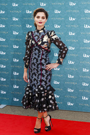 Jenna-Louise Coleman paired her lovely dress with black open-toe platform sandals.