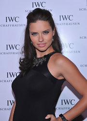 Adriana Lima swept half her hair up into a casual style for the IWC flagship boutique opening in NYC.