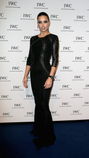 Adriana Lima vamped it up at the IWC gala in a figure-hugging black Zuhair Murad gown featuring leather lace-up detailing on the bodice.