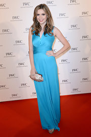 Carly Steel kept her red carpet look classic and elegant with a sky blue column-style dress.