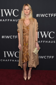 Alice Eve layered a gold duster coat over a patchwork midi dress for the IWC Schaffhausen Tribeca Film Fest event.