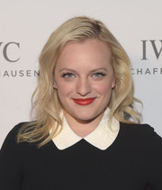 Elisabeth Moss wore her hair down to her shoulders with a side part and gentle waves at the IWC Schaffhausen Rodeo Drive grand opening.