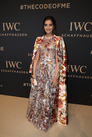 Sonam Kapoor polished off her gown with a matching floor-length coat.