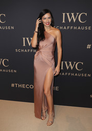 Adriana Lima amped up the elegance with strappy gold heels.