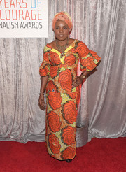 Solange Lusiku Nsimire brought a bold pop to the IWMF Courage in Journalism Awards with this festive orange and yellow print dress.
