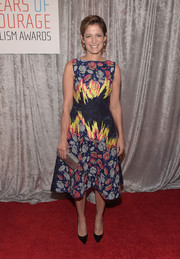 Cindi Leive attended the IWMF Courage in Journalism Awards wearing a colorful embroidered cocktail dress.