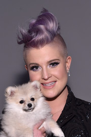 Kelly Osbourne attended the Idan Cohen fashion show rocking her signature lavender mohawk.