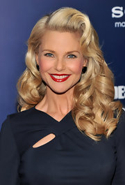 Christie Brinkley was pin-up girl chic with her long sexy curls and va-va-voom red lips at 'The Ides of March' premiere in NYC.