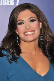 Kimberly Guilfoyle added an ultra-feminine touch to her ensemble with a pair of crystal chandelier earrings.