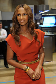 Iman showed off her long brown curls, which she accented with a center part.
