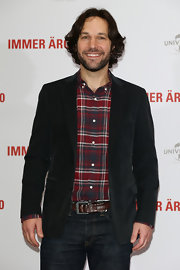Paul Rudd dressed down his red carpet look with a red plaid button down.