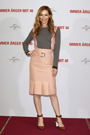 "Leslie Mann looked feminine and sweet in a fitted Marni skirt with pleated hem and buckle belt at the Berlin premiere of ""This is 40."""