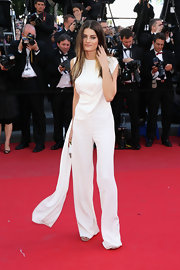 Isabeli Fontan broke the red carpet mold when she wore this crisp white jumpsuit that featured a fun and delicate train detail.