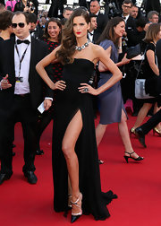 Izabel Goulart brought out the wow factor when she rocked this black strapless gown with a thigh-high leg slit.