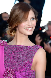 Bianca Balti pinned up her hair into a low twisted bun for a soft and romantic look on the red carpet.