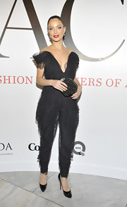 Georgina Chapman topped off her daring jumpsuit with black patent leather platform pumps.