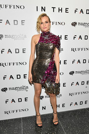 Diane Kruger balanced out her busy-looking dress with simple black sandals by Stuart Weitzman.