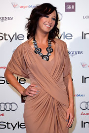 "Layne Beachley showed of her shoulder length curls while attending the ""InStyle"" event in Australia."