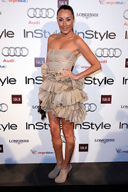 Terry Biviano showed off her nearly nude strapless dress which was embellished with fabric on the skirt.